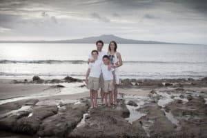 Family portrait at Castor Bay beach - Auckland